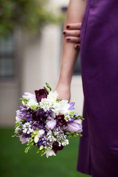 well balanced bridesmaid bouquet against the purple dress.