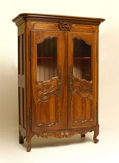 French, Nimoise, Regence period armoire: In solid, carved walnut.  Shown here with chicken-wire.  Early 18th century.