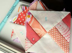 I really like this block - sew three strips together and then a solid on the other side and cut in triangles?