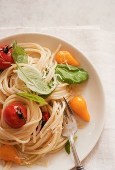 Great easy pasta to highlight homegrown or farmers market fresh tomatoes and basil. To make parve, substitute capers for Parmesan cheese.