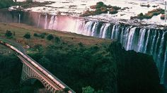 Crossing the Zambezi River on its landmark bridge is like living on a movie set, the mist of Victoria Falls thundering upward on one side, the dark rocks of the gorge plunging down on the other.