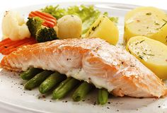 cooked salmon and vegetables