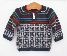 I took the general idea of this adult sweater  (free pattern) and made a baby one - great for using up scraps of 4 ply. on Ravelry
