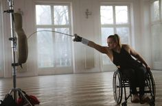 modernfencing:  hemaphilia:  Fencing is for All.Via Iks-Awf Nowicki   [ID: a wheelchair epee fencer practicing lunges with a dummy.]Jadzia Pacek!