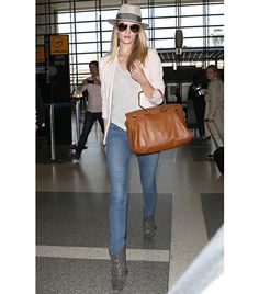 @Who What Wear - Rosie Huntington-Whiteley                 The model elevates an outfit of neutral hues--a Maison Michel hat, Reese + Riley Dream Blazer ($381) in Pale Pink, and gray Isabel Marant boots--with Viktor & Rolf's Bombette Bag ($1995, available for preorder at 416.861.6251) in Nuts.