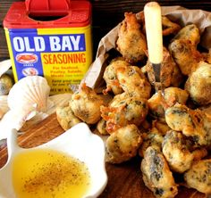 'Popcorn' Oysters: 2-8oz. cans of Whole Oysters & their reserved liquor , 1/2 cup of Flour, 1/2 cup of Corn Meal, 1 beaten Egg, 1 pinch of Salt & Sugar, Old Bay for sprinkling..optional, but come on now!, Butter for melting/dipping, Oil for frying.