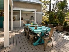 Outdoor dining space with a bright turquoise trestle table