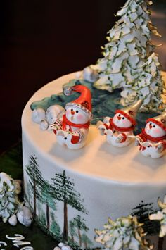 Christmas cake posted by Boyka at Cake Central. Pretty Christmas trees, really cute  and well-executed snowmen