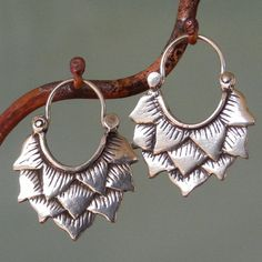 Hey, I found this really awesome Etsy listing at https://www.etsy.com/listing/76206147/lotus-earrings-larger-silver-hoop