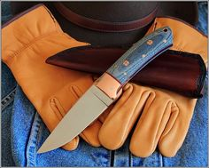 """Home grown """"micarta"""" -Make Fabric stablaized Resin for Handles etc. Love the copper on this knife!"""