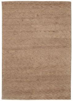Ces tapis sont fabriqués en Inde. Ils sont connus pour leurs motifs un peu naïfs, primitifs, au charme rustique.