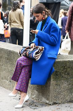 OVERSIZED COBALT BLUE COAT IS WORN WITH A FUN PAIR OF ENERGETIC PURPLE PATTERNED PANTS.  BRIGHT COLORS FOR FALL SHOULD BE IN YOUR CLOSET.