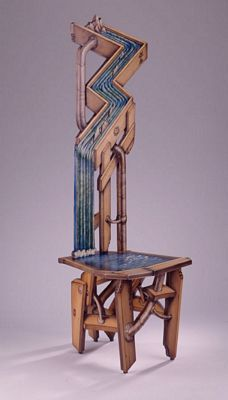 "Conservation Chair, ca. 1998  John Cederquist  Baltic birch plywood, Maple, Sitka spruce, epoxy resin, aniline dyes, lithography inks   60 1/2"" x 19 3/4"" x 24 5/8"" (153.7 x 50.2 x 62.5cm)"
