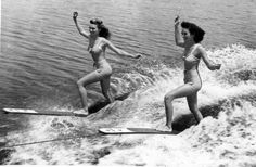 On one ski! Women water skiers performing at the Cypress Gardens theme park in Winter Haven, Florida.