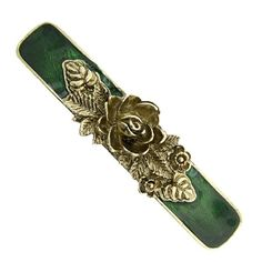 Pin your hair back the fashionable way with this gold-toned barrette. A three dimensional gold-toned rose is surrounded with a medley of leaves and flowers. The barrette bar has an emerald green enamel coating that compliments the gold tone in an elegant fashion.