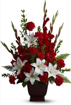 Red and white funeral flowers offer love, peace, and fond memories of a loved one. Funeral flower arrangements are hand-delivered by a local florist. Christmas Flower Arrangements, Funeral Flower Arrangements, Christmas Flowers, Beautiful Flower Arrangements, Beautiful Flowers, Christmas Tables, Romantic Flowers, Christmas Centerpieces, Funeral Bouquet
