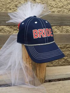 Bride to be hat and veil with custom baseball theme. Looking for a themed bridal shower gift? Look no further this beautiful baseball themed bride-to-be veiled baseball cap in brides favorite baseball teams colors is perfect for your night out! Whether your going out to the club or having bridal shower at home she will love being the center of attention in her veiled bride cap in colors of her choice. Bridal party package deals available! #bridetobe #bridehats #bridehatandveil