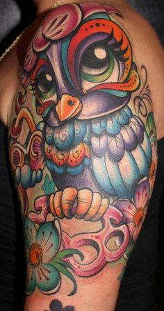 Love this colorful owl tattoo