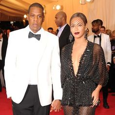 2014 Met Gala Red Carpet: Description: Beyonce in Givenchy Couture with Jay Z. Shares Per Hour:Viral=1.44K