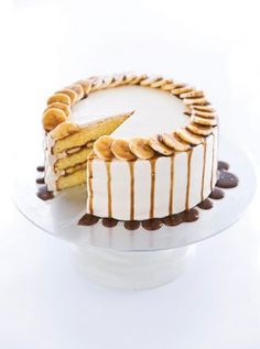 "Oh my this looks yummy. ""We fill layers of yellow cake with bananas cooked in a rum-laced caramel. The fluffy frosting gets a generous dose of rum, as well, in our Bananas Foster Cake. Caramel, Cake Recipes, Dessert Recipes, Baked Alaska, American Desserts, Classic Desserts, Just Cakes, Round Cake Pans, Pretty Cakes"