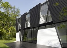 Architecture, Attractive Unique Monochrome Architecture Of House Design In Kent England Featuring Black And White Exterior With Wooden Panel And Green Grass Lawn: Elegant Unique Home Design Concept with Two Toned Exterior to Try