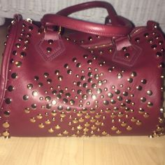 Beautiful Ruby Red Purse Cute bag with red leather and gold studs. Great condition just never use it. MMS Bags Shoulder Bags