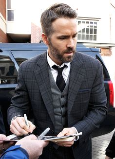 Ryan Reynolds outside the Hasty Pudding Club signing some autographs for fans on January 3, 2017 in Cambridge, Mass.