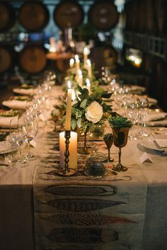 Dark and dreamy wedding reception - love the feather table runner