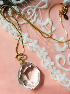 14K gold snake chain with faceted clear quartz crystal