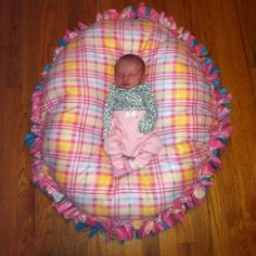 No-sew floor pillow pouf, made just like a tie fleece blanket but stuffed with poly-fil.  - Click image to find more DIY & Crafts Pinterest pins
