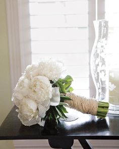 This classic bouquet of white peonies is wrapped in hemp for an earthy touch