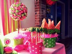 Watermelon birthday party. Watermelon cake pops, watermelon slice rice crispy treats. Ribbon topiaries to match.