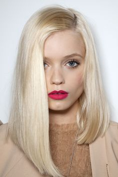 Abbey Lee Kershaw. Asymmetrical bob & fuchsia lipstick #style #beauty #hair #fashion