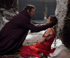 """Hugh Jackman and Anne Hathaway  In the musical adaptation of """"Les Miserables"""" (2012) plays Anne Hathaway """"Fantine"""" who prostitutes herself to pay the foster parents of their daughter """"Cosette"""". Anne Hathaway was honored for her performances with an Oscar for Best Supporting Actress."""