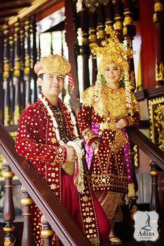 South Sumatra wedding couple at Traditional home.