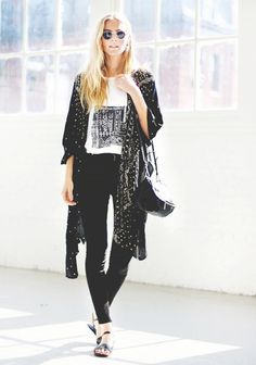 A graphic tee is worn with black jeans, sandals, a printed kimono and crossbody bag.
