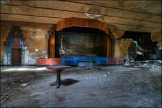 Abandoned ballroom in Detroit, Michigan.(photo via flickr)  Designed and built in 1929, the ballroom was a major venue for bands of the 1930's and 1940's. Built in an Art Deco styling with an Aztec theme, at 5600 square feet, it was meant to hold around a 1000 couples. The maple dance floor was built on springs to give the dancers a bounce as they moved. It now sits empty and neglected like many other historic places in Detroit