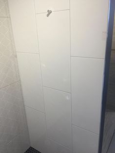 White large format field tile from Art Tile in Oakland. To be used for shower walls in same vertical pattern as shown in Show Room installation. #whitetiledbathroom