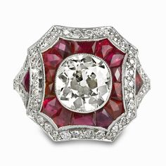 Diamond and Ruby Art Deco-style Ring  Made of platinum, this art deco-inspired ring bares an old mine, cushion cut 1.87 carat K-SI1 diamond at its center while being surrounded with intricately [...]