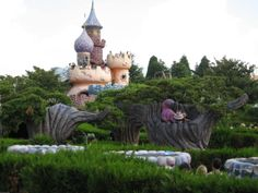 Disneyland Paris. Alice's Curious Labyrinth in Fantasyland with the Queen of Hearts Castle an the Chesire Cat in his tree
