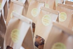 Edible wedding favor idea - sweet treats in paper bags with personalized scalloped stickers {Willow Noavi Photography}