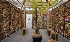 Custom-designed stools made from short bamboo poles tied together with rattan were placed inside the pavilion in a square courtyard-like space.