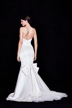 A stunning duchesse satin mermaid wedding dress from Truly Zac Posen, designed to play up your curves. A back bow adds a dramatic flourish. Exclusively at David's Bridal.