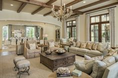 Eclectic Living Room with Hardwood floors, Big Weathered Hammered Copper Bowl, French doors, Exposed beam, Transom window
