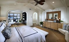 Residence 1x - Soaring ceilings and attractive archways in this sprawling master bedroom suite at The Estates I New Homes at Del Sur in San Diego.