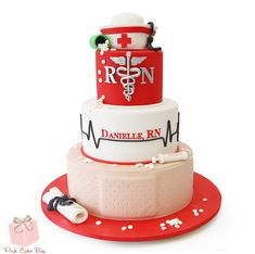 Danielle's graduation from nursing school was celebrated with this three tier graduation cake. The top of the cake includes a nurses's cape with a black gr