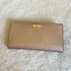 ‼️FLASH SALE‼️Kate Spade Wallet Kate Spade Wallet in rosegold has a snap open/close, zipper coin  pocket in back, lots of Card and bill slots, cute material accents, excellent condition and NWT. kate spade Bags Wallets