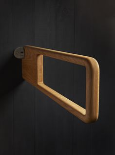 Holt wooden drop down grabrail for disabled toilets. Designed by Alex Mowat. Manufactured by Allgood.