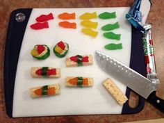 """Adorable! Candy """"sushi"""" made out of swedish fish, fruit roll-ups and rice krispie treats!"""