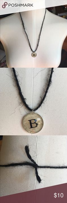 Handmade Black Twine 'B' Initial Necklace Beautiful handmade black twine necklace featuring a silver-coated beige pendant with the initial 'B' in the center. Approx. 12.5 inches, including pendant. Only one available. Handmade Jewelry Necklaces